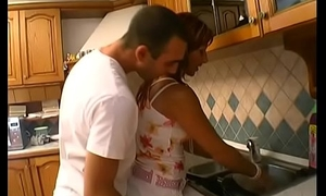 Young stud licks  and drills brunettes wet pussy on kitchen counter